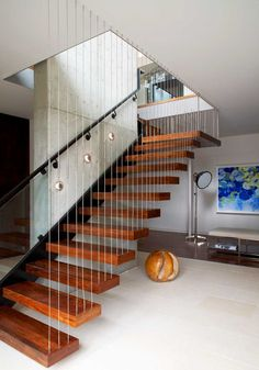 floating stair with cable guardrail support