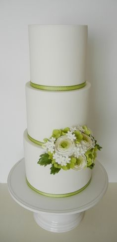 Clean and simple...three tiers with ranunculus sugar flowers...by Petalsweet.