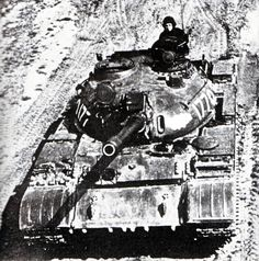 Nomination to the firing line of a medium tank T-55M on the training ground in the Leningrad Military District. End of 70-ies. Features is that modification of the laser rangefinder KTD-2, RMSh tracks and new towers overlap charging hole course machine gun in the forehead of the tank shell. So, this is the earliest machine after modernization. This is indicates it is in 1976.