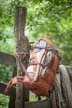 """Full-functional large hiking backpack of oiled leather and weathered canvas. One side entrance and one large internal pocket, one external pocket and a """"beaver tail"""" system."""