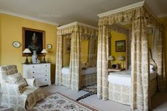 guest bedroom in Wales with fetching floral canopy beds