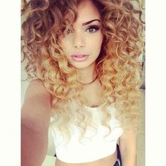 Curly girl with long ombre hair & perfect eyebrows.