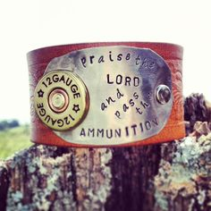 """Praise the Lord and pass the ammunition"" leather cuff with shot gun shell from Dirt Road Girls shop"