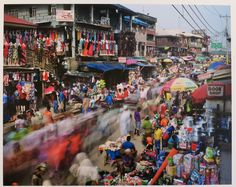 How do people manage to live in the world's biggest cities? Dutch photojournalist Martin Roemers set out to answer this question in 'Metropolis,' a series that took him around the world to cities with populations of ten million or more. Roemer discovered that to survive is to focus on the details of everyday life, as he does in this colorful market in Lagos. (On view at Anastasia Photo on the Lower East Side through April 26th). Martin Roemers, Oshodi Road, Oshodi, Lagos, Nigeria, archival…