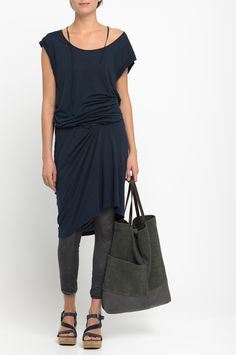 Humanoid - navy dress with suede bag. Love the neutral, yet dark palette.