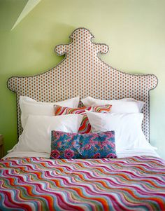 In this colorful bedroom a Victorian bed from Annie Selke Home collection for Vanguard Furniture is upholstered in Seema from Calico Corners.