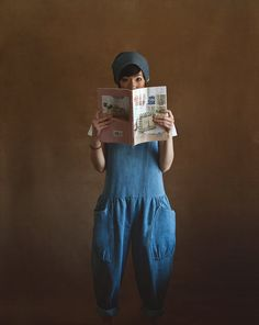 "denim ""overalls""/jumper.  look at those full pants and pockets.  hum.  cute!  i yhink so."
