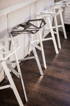 Buy one bar stool that's odd in some way relative to the others