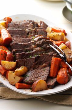 """When juicy pot roast simmers in garlic, onions and veggies, everyone comes running to ask, """"When can we eat?"""" The answer? Just wait…it will be worth it. 