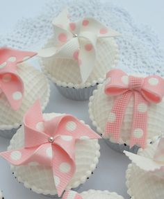Pink and White Polka Dot Windmills and Bows Cupcakes. Another cute idea for a baby girl shower treats!