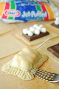 Amazing smore's cookies just use regular sugar cookie dough and bake till the time says cut out squares put the chocolate and marshmallows on then cover with another piece then crimp the side and enjoy!! ( may add sticks for cookie pops !)