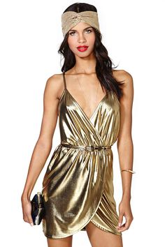Channel your inner Bianca in this sexy gold metallic party dress with a plunging wrap front and s...