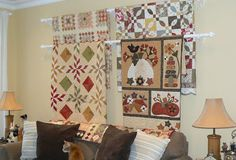 clever way to display quilts!