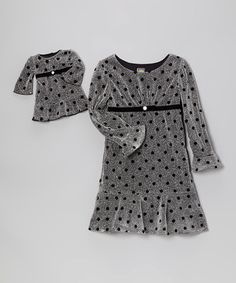 For twice the charm, this adorable set makes the perfect duo for playtime, party time or anytime! With its sparkling finish and playful polka dots, this fully lined dress is all set to curtsy gracefully with Dolly.Includes dress and doll dressDoll dress fits most 18'' dollsBody: 70% polyester / 30% metallic thread<...