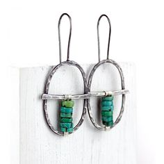 These hoop earrings are created with recycled silver and natural turquoise heishi beads. They are oval shaped to fit the colorful stack of blues