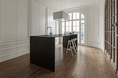 i29 interior architects designed an invisible kitchen that feels more like pieces of furniture as opposed to an entire room devoted to just the kitchen.