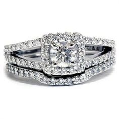 I could go for this design -- which is how it's done traditionally (wedding ring on bottom of engagement ring). Or I could get a separate wedding ring for my left hand and wear my beautiful engagement ring on my right. :)