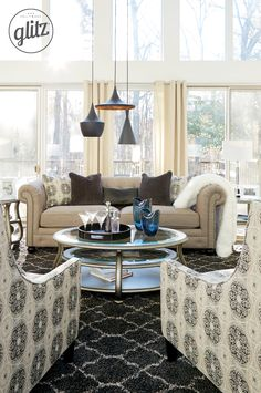 Sit back and relax in glamorous style with the Azlyn Sofa. The button tufted design is an instant A-Lister for style. Just add in silver accessories, shiny accents and your favorite pieces in neutral colors, and you're all set for the perfect Hollywood-inspired oasis! Hollywood Glitz - Ashley Furniture - #HollywoodGlitz #AshleyFurniture - Living Room Ideas