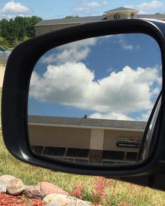 Objects in mirror are closer than they appear. #lookagain #randomdudeonaroof #mirror #nofilter #reflection