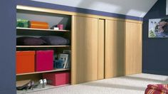 Storage under sloping walls. Sliding doors for cupboards will be an excellent idea to save space.