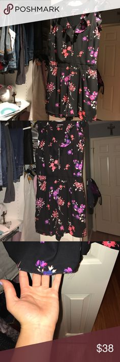 Express black floral romper! Hardly worn! The only thing is the one leg has the hem out, but can easily be sowed or sticker back up. Haven't had the time! Too big for me! Price reflects. Willing to negotiate Express Pants Jumpsuits & Rompers