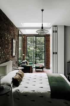 Bedroom with Exposed Brick Wall - Bedroom Design Ideas. of bedroom ideas from design and furniture to storage and wallpaper on HOUSE. Bedroom Wallpaper Accent Wall, Brick Wall Bedroom, Bedroom Wall Colors, Home Decor Bedroom, Bedroom Ideas, Bedroom Bed, Brick Wall Decor, Bedroom Rustic, Master Bedroom