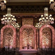30,000 #roses, 16ft high #floral walls, and 3 arches make for one magnificent ceremony setting. #Repost: @davinciflorist