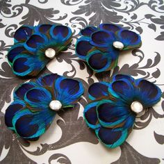 Hair pieces? Brooches?  Love the peacock style!!