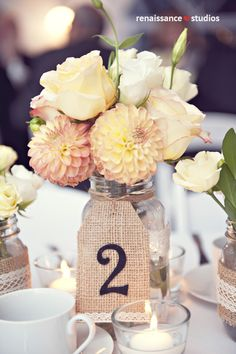 Beautiful wedding centerpiece with burlap table numbers. Wedding Table Decorations, Wedding Table Numbers, Table Centerpieces, Wedding Centerpieces, Diy Wedding, Rustic Wedding, Wedding Flowers, Dream Wedding, Wedding Day