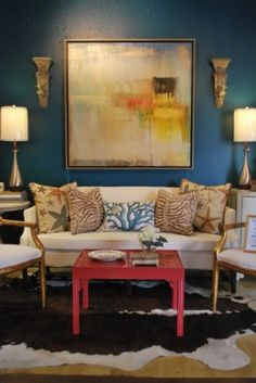 Eclectic LR by Anna Baskin Lattimore Design.  Note the coastal zebra pillow mix, large abstract painting.