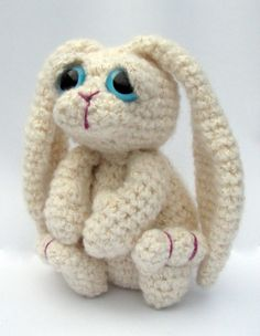 Bramble Bunny... This is a crochet pattern for Bramble the Bunny, with written instuctions in UK terms (If you are used to American terms don't worry the differences are all explained in the pattern).    He can be made from any 100g ball of dk, worsted or Aran yarn and a 3mm Hook and measures about 4-6 inches depending which yarn and hook you use.    This is an Intermediate Pattern