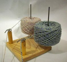 "A Yarn Ball holder that holds two balls of yarn. Perfect for 2 color knitting and any other application that requires 2 balls of yarn. This is the big ""sister"" of the Yarn Pet. It has a 7"" x 7"" x 13/64"" thick Maple hardwood base (same size as our Jumbo Lazy Kate). It has 3 mounting holes (2 on adjacent corners so that"