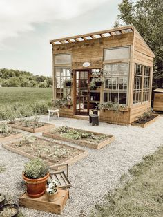 How I Built my Dream Greenhouse - Arrows & Twine Backyard Greenhouse, Backyard Landscaping, Greenhouse Tables, Diy Greenhouse Plans, Farmhouse Garden, Garden Cottage, Farmhouse Greenhouses, Farmhouse Sheds, Modern Greenhouses