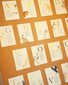 Animal-themed alphabet cards reveal seating assignments. Guests' names were printed by table on each card, and matching cards awaited in centerpieces