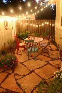 Patio ideas for my little side yard.  Love the lights
