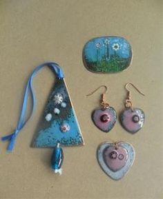 I like how she solved the trunk with a punched hole and bead. Shelley Lodge  Contemporary Enamels - Enamelling