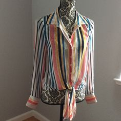 ❣3/$25 or5/$35 Banana republic stripe sheer top In excellent pre loved condition. No rips or stains. Button down with tie at the bottom. Colors are white, coral, yellow and black. The tags do not have a size. Please ask for measurements. This would fit best a medium/large. Banana Republic Tops Button Down Shirts