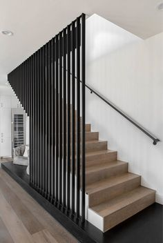 Modern Farmhouse Residence / Cornerstone Architects - - This modern farmhouse residence showcases the transitional blending of modern and traditional elements. By Cornerstone Architects. Staircase Design Modern, Stair Railing Design, Home Stairs Design, Stair Decor, Interior Stairs, Modern House Design, Staircase Ideas, Black Staircase, Modern Houses