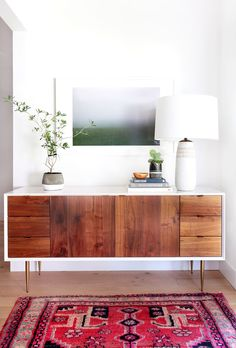 Wood console table in white entryway with your favorite art piece.