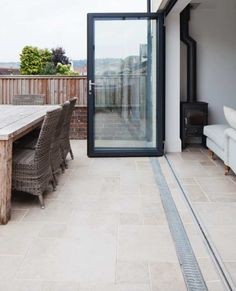Think about depth of patio needed for bifold doors. Could have narrower patio with sliders. Outside Flooring, Outdoor Flooring, Stone Flooring, Kitchen Flooring, Patio Tiles, Outdoor Tiles, Outdoor Stone, Patio Fence, Patio Doors