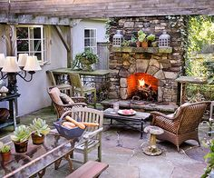 We would love to come home to this welcoming outdoor space! More outdoor fireplace ideas: http://www.bhg.com/decorating/fireplace/outdoor/outdoor-fireplace-ideas/?socsrc=bhgpin062313stonefireplace=16