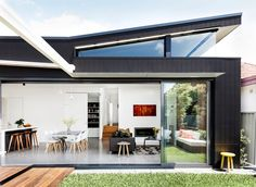 "A wraparound clerestory window was designed to capture northern light. The rear elevation is clad in [James Hardie](http://www.jameshardie.com.au/?utm_campaign=supplier/|target=""_blank"") Scyon Axon cement-composite panels. Dining table, [Space](http://www.spacefurniture.com.au/?utm_campaign=supplier/