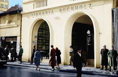 Via București Librăria Buchholz - Calea Victoriei nr.45, februarie 1941  Reproducere color: Alberto Groșescu Fotografie originală: Willy Pragher