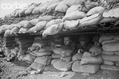 02 Mar 1968, Khe Sanh, South Vietnam --- Observing. Khe Sanh, South Vietnam: Marines peer through an opening in a bunker at this beleaguered outpost in northern South Vietnam March 2nd.  #VietnamMemories
