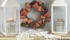 How to make a living succulent wreath with mini flower pots. Love this spring craft!