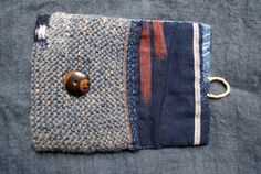 unusual pouch , entirely hand sewn and hand knitted in vintage Japanese cotton, in autumnal shades of earth and indigo, and in pure wool dyed with indigo and garance    the closing system is handmade in linen twine and a vintage button    the inner filling is 100 % cotton    this pouch is perfect for men and women as well    size : 14 cm x 12,3 cm    in case of multiple purchases, please, contact me for the shipping costs...  thank you for your visit at Le Samovar...