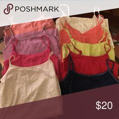 Bundle of nine camisoles. Two lace camisoles one brand new with tags.  (White and navy)Six comfy cotton camisoles (red, fuchsia, light purple, peach, pink, yellow-lime) and one nylon camisole(white). Tops Camisoles