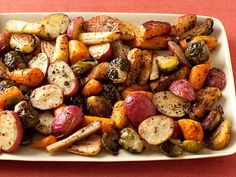 Roasted Vegetables : Giada roasts root vegetables with Brussels sprouts and dried herbs.