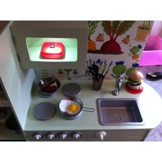 Just need to add some handles, but somebody couldn't wait to use it anyway. Wooden Play Kitchen, Diy Kitchen, Kitchen Appliances, Home Decor, Wooden Toy Kitchen, Diy Kitchen Appliances, Home Appliances, Decoration Home, Room Decor