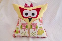 "Put the finishing touches on your baby nursery with this cute Owl shaped pillow. The combination of pink, yellow, and green gives off a fun vibe. Pair it with the coordinating  Owl print window valance that's also sold in this etsy shop.        16"" decorative pillow By- BEAUTY FROM ASHES DECOR"